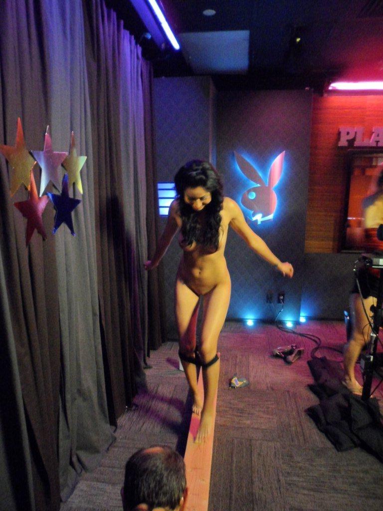 Nude girl balance beam